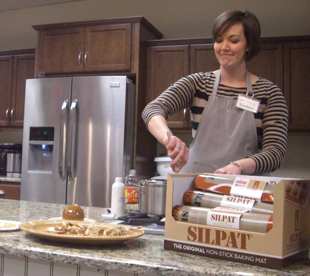 Lindsey Owens, manager of Love To Cook, makes caramel in the store's demonstration kitchen at the Newgate Mall in Ogden.